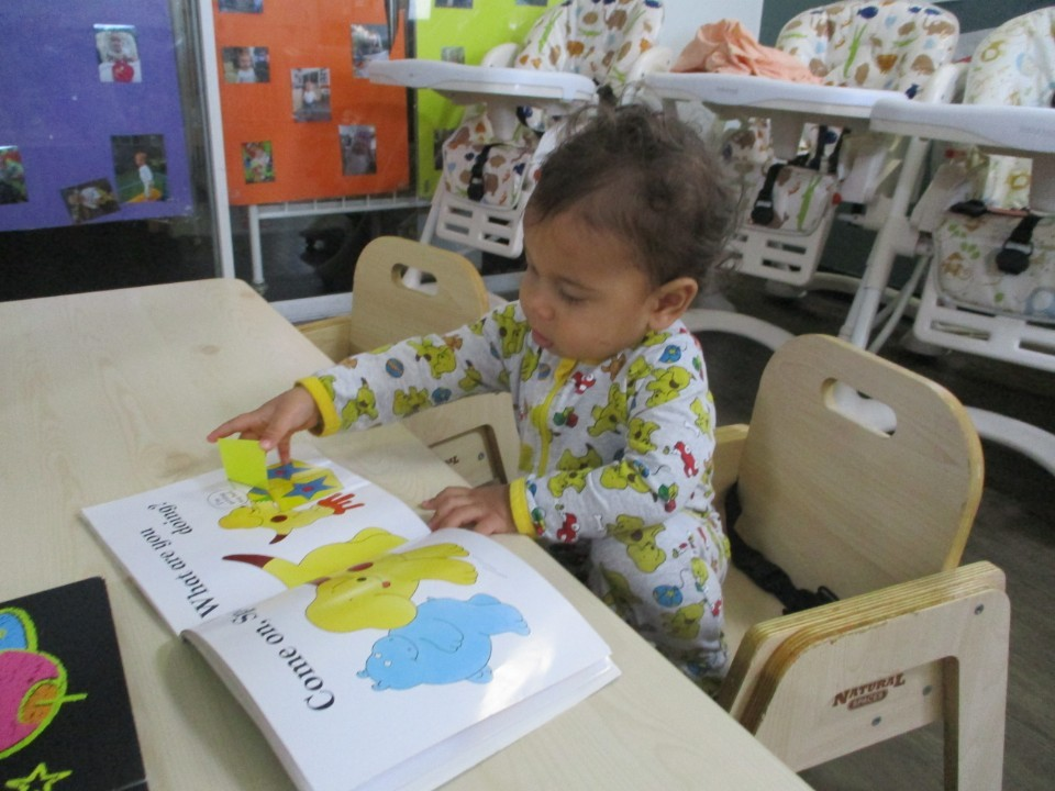 child reading story book