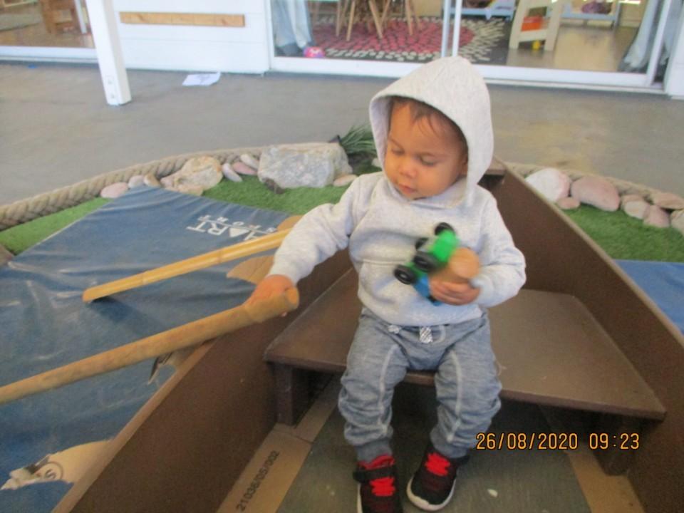little boy rowing the boat